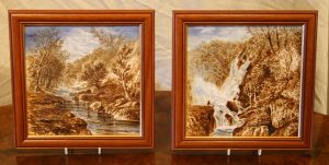 Pair of hand painted and signed Victorian tiles depicting scenes in the Yorkshire Dales