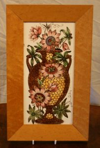 Victorian ceramic tile depicting an urn with passion flowers