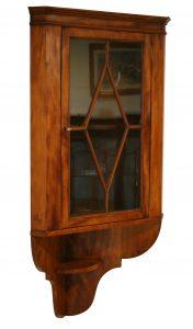 A Victorian satin birch corner cabinet
