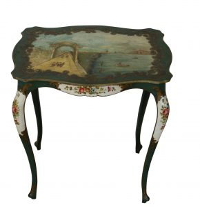 A continental painted table with serpentine top