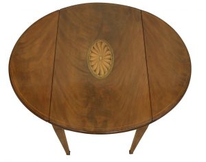 A Victorian mahogany pembroke table in the Sheraton style