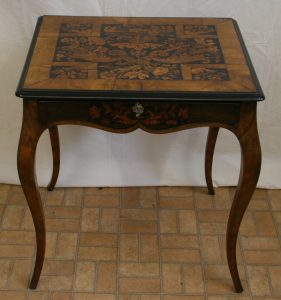 A Walnut centre table in the French style