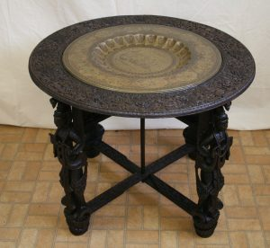 An Indian hardwood centre table with brass tray