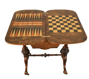 A Victorian inlaid walnut work and games table
