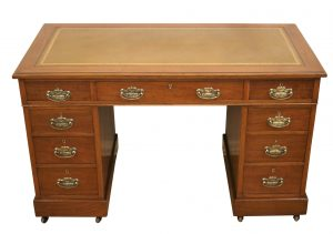 An Edwardian walnut pedestal desk