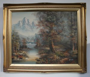 A painting of an Autumn forest and mountains by Harry Marriott Burton