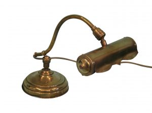 A Victorian brass desk lamp