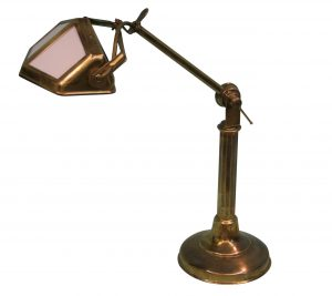 An Edwardian brass desk lamp
