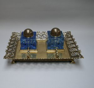 A Victorian brass ink stand