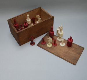 "A late 19th century English carved and turned bone ""barleycorn"" chess set"