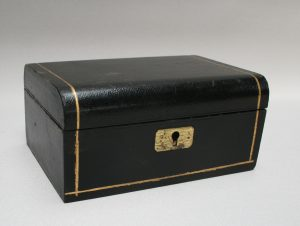 A small black leather jewellery box