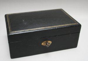 A rectangular black leather jewellery box